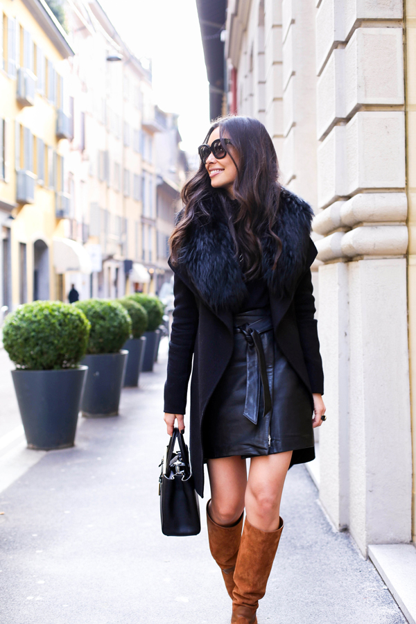 black leather skirt with brown boots